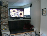 Brick love seat with HDTV above