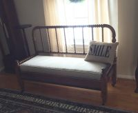 Antique bench made from spindle bed