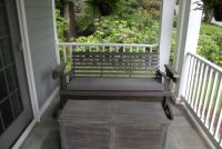 old swing. new sunbrella charcoal bench cushion