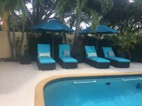 Poolside Chaise Cushions and Umbrellas