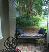front porch swing with sunbrella cushion & pillows